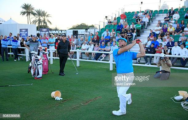 Bryson DeChambeau of the United States and Matthew Fitzpatrick of England demonstrate their skills during the 'Stars and Stripes' Clinic under the...