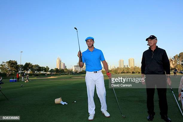 Bryson DeChambeau of the United States and the renowned golf coach Pete Cowen during the 'Stars and Stripes' Clinic after the first round of the 2016...