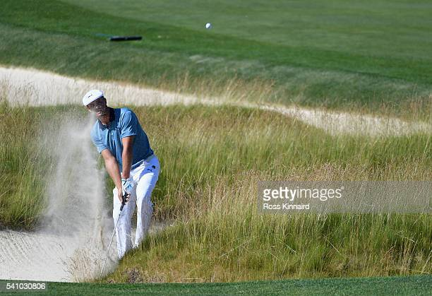 Bryson DeChambeau of the United States hits a shot from the church pew bunkers on the third hole during the continuation of the second round of the...