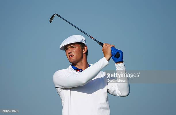 Bryson DeChambeau of the United States hits his tee shot on the 15th hole during the continuation of the third round of the Abu Dhabi HSBC Golf...