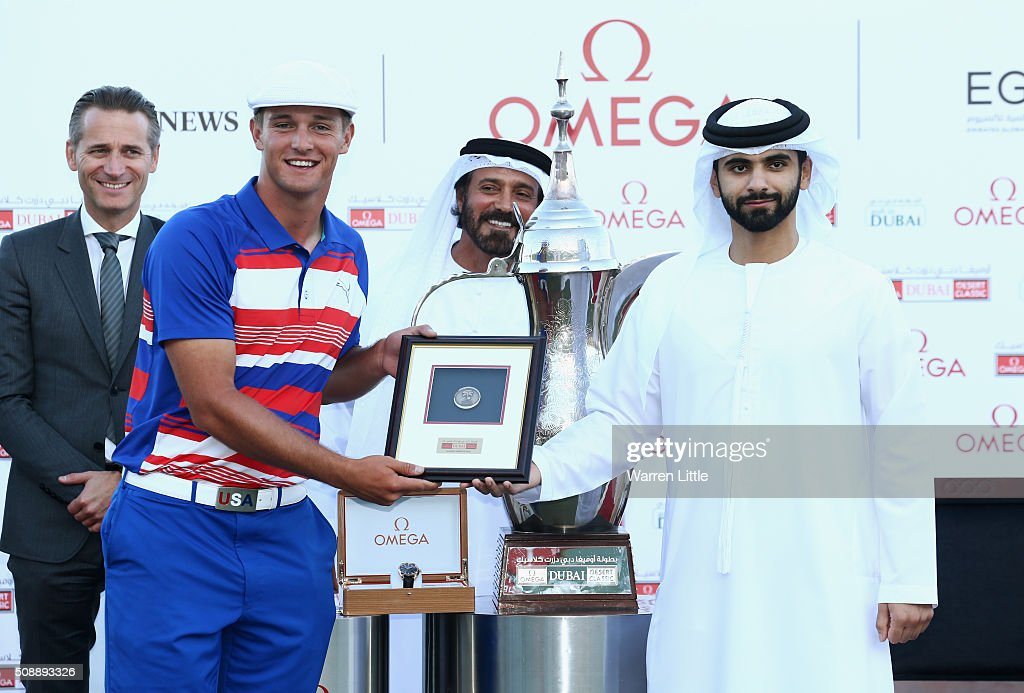 Bryson DeChambeau of the United States is presented his best amateur award by Sheikh Mansoor bin Mohammed bin Rashid al-Maktoum after the final round of the Omega Dubai Desert Classic at the Emirates Golf Club on February 7, 2016 in Dubai, United Arab Emirates.