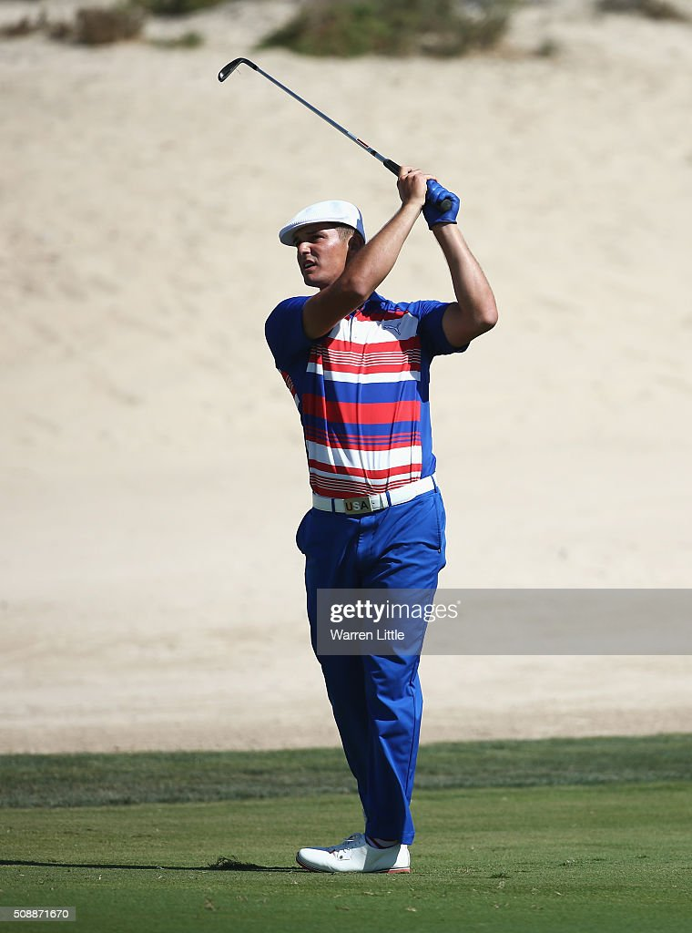 Bryson DeChambeau of the United States plays his second shot on the 8th hole during the final round of the Omega Dubai Desert Classic at the Emirates Golf Club on February 7, 2016 in Dubai, United Arab Emirates.