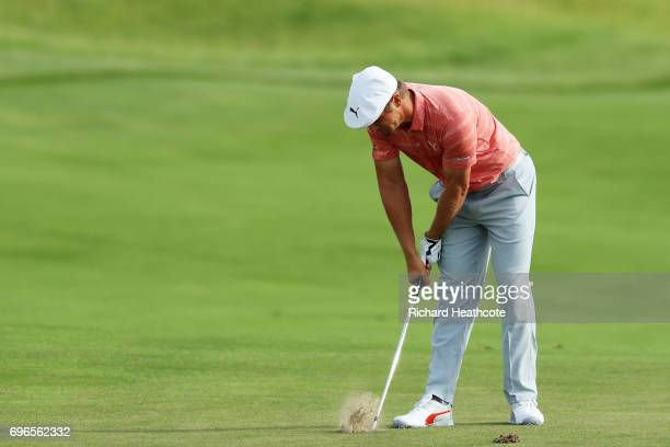 Bryson DeChambeau of the United States reacts after playing his shot on the first hole during the second round of the 2017 US Open at Erin Hills on...