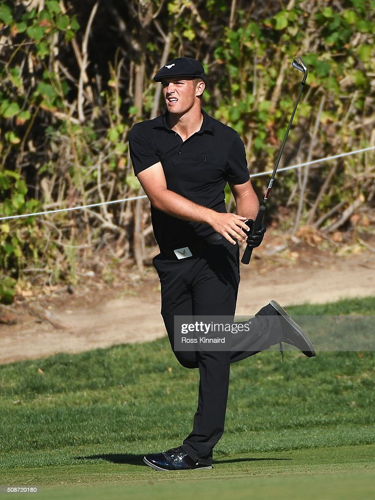 Bryson DeChambeau of the United States reacts to his second shot on the 18th hole during the third round of the Omega Dubai Desert Classic at the Emirates Golf Club on February 6, 2016 in Dubai, United Arab Emirates.