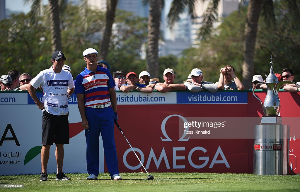 Bryson DeChambeau of the United States talks with his caddie on the 1st tee during the final round of the Omega Dubai Desert Classic at the Emirates Golf Club on February 7, 2016 in Dubai, United Arab Emirates.