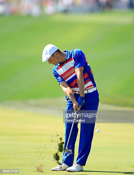 Bryson DeChambeau of the United States the 2015 US Amateur Champion plays his second shot at the par 4 first hole during the final round of the 2016...