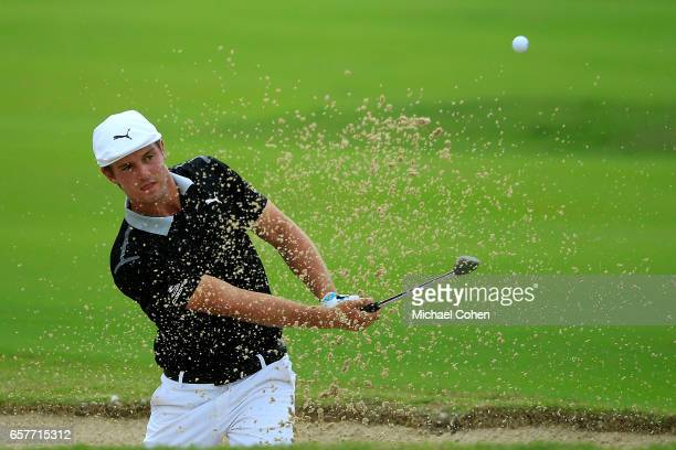 Bryson DeChambeau plays his third shot out of the bunker on the fifth hole during the third round of the Puerto Rico Open at Coco Beach on March 25...