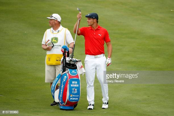 Bryson DeChambeau pulls a club from his bag on the 15th hole during the final round of the John Deere Classic at TPC Deere Run on July 16 2017 in...