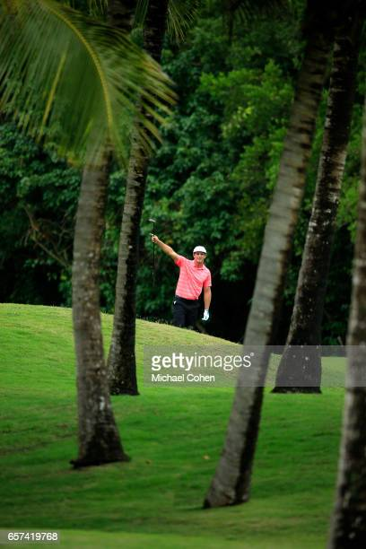 Bryson DeChambeau reacts after his second shot on the 18th hole during the second round of the Puerto Rico Open at Coco Beach on March 24 2017 in Rio...