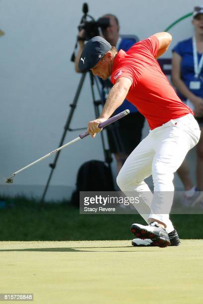 Bryson DeChambeau reacts to a birdie putt on the 18th green during the final round of the John Deere Classic at TPC Deere Run on July 16 2017 in...