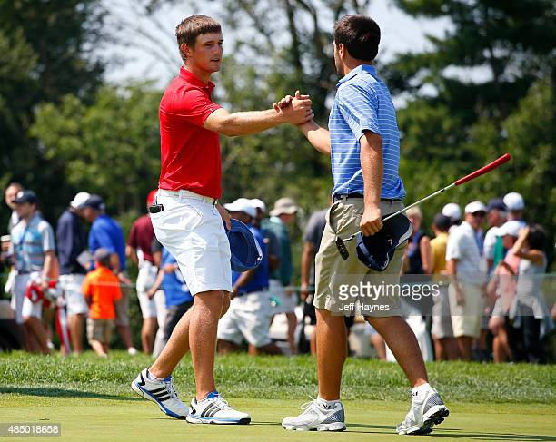 Bryson DeChambeau shakes hands with Derek Bard after their first 18 holes during the final match of the US Amateur Championship at Olympia Fields...