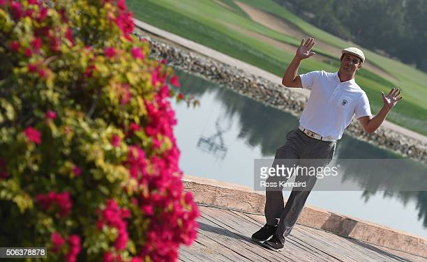 Bryson DeChambeau the amateur from the USA waves to the camera on his way on to the 7th tee during the continuation of the second round of the Abu...