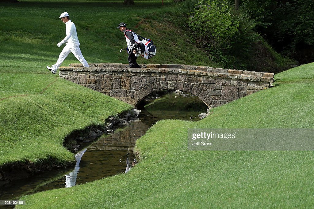Bryson DeChambeau walks across the bridge on the 13th hole during the first round of the Wells Fargo Championship at Quail Hollow Club on May 5, 2016 in Charlotte, North Carolina.