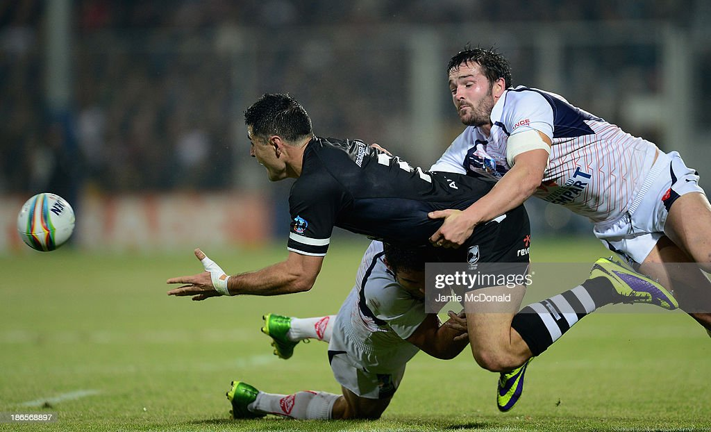 Bryson Goodwin of New Zealand is tackled by Thomas Bosc of France during the Rugby League World Cup group B match between New Zealand and France at Parc des Sports on November 1, 2013 in Avignon, France.