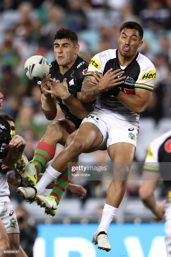 Bryson Goodwin of the Rabbitohs and Waqa Blake of the Panthers compete for the ball froma kick during the round 17 NRL match between the South Sydney Rabbitohs and the Penrith Panthers at ANZ Stadium on July 2, 2017 in Sydney, Australia.