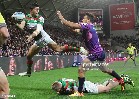 Bryson Goodwin of the Rabbitohs attempts to pass the ball back as he leaps over the dead ball line during the round 10 NRL match between the...
