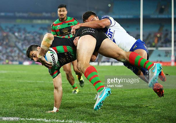 Bryson Goodwin of the Rabbitohs takes a high ball and dives to score a try during the round 24 NRL match between the South Sydney Rabbitohs and the...
