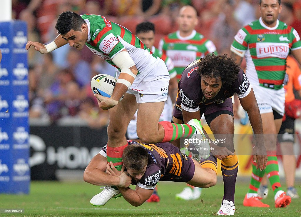 Bryson Goodwin of the Rabbitohs takes on the defence during the round one NRL match between the Brisbane Broncos and the South Sydney Rabbitohs at Suncorp Stadium on March 5, 2015 in Brisbane, Australia.