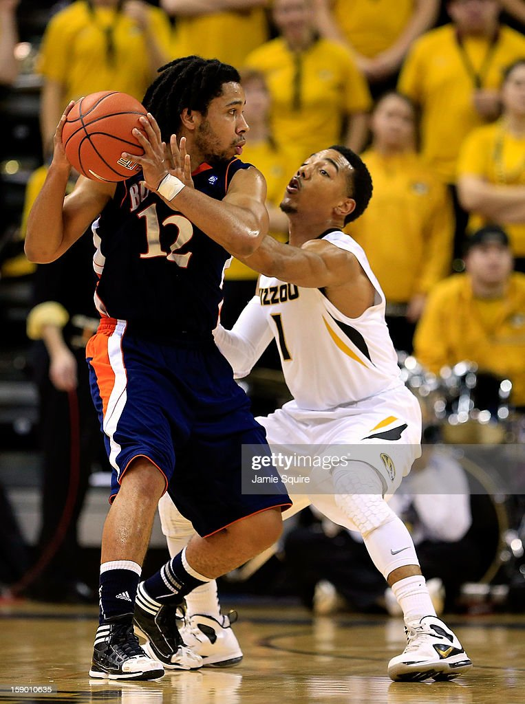 Bryson Johnson #12 of the Bucknell Bison controls the ball as Phil Pressey #1 of the Missouri Tigers defends during the game at Mizzou Arena on January 5, 2013 in Columbia, Missouri.
