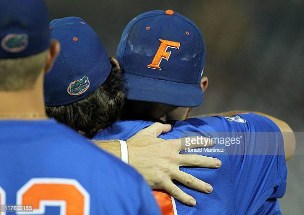Bryson Smith of the Florida Gators hugs Justin Poovey after losing game 2 of the men's 2011 NCAA College Baseball World Series at TD Ameritrade Park...