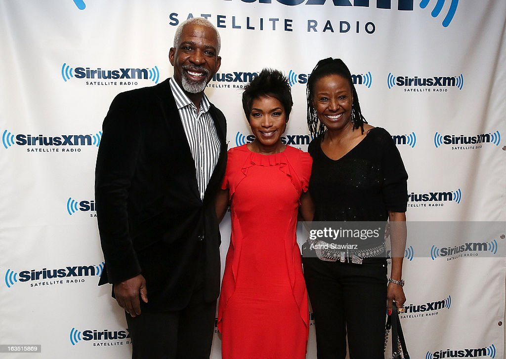B.Smith (R) and Dan Gasby (L) pose for a photo after interviewing actress <a gi-track='captionPersonalityLinkClicked' href=/galleries/search?phrase=Angela+Bassett&family=editorial&specificpeople=171174 ng-click='$event.stopPropagation()'>Angela Bassett</a> (C) during her visit to the SiriusXM studios on March 11, 2013 in New York City.