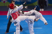 Btriseida Acosta of Mexico competes with Lashondra Rawls of USA during a women's 73 kg of WTF World Taekwondo Championships 2013 at the exhibitions...