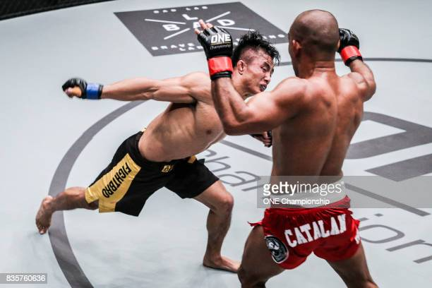 Bu Huo You Ga moves to attack Rene Catalan during ONE Championship Quest For Greatness at the Stadium Negara on August 18 2017 in Kuala Lumpur...