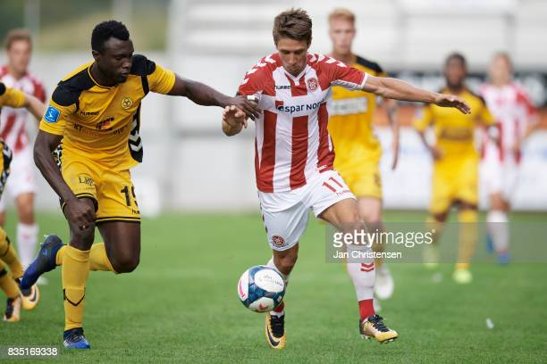 Bubacarr Sanneh of AC Horsens and Jakub Sylvestr of AaB Aalborg compete for the ball during the Danish Alka Superliga match between AC Horsens and...