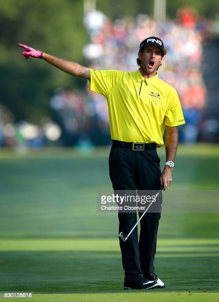 Bubba Watson alerts spectators by yelling that his ball is going wide following his second shot on the first fairway during first round action of the...