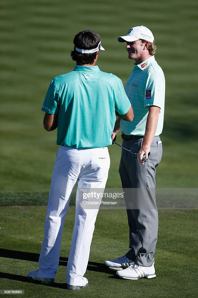 Bubba Watson and Brandt Snedeker talk on the 17th hole during the third round of the Waste Management Phoenix Open at TPC Scottsdale on February 6, 2016 in Scottsdale, Arizona.