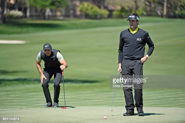 Bubba Watson and Jason Day of Australia on the green at No 5 during the first round of the Arnold Palmer Invitational presented by MasterCard at Bay...