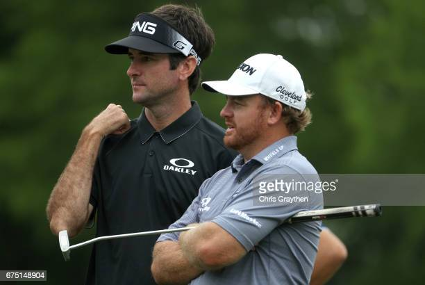Bubba Watson and JB Holmes prepare to putt on the first hole during the final round of the Zurich Classic at TPC Louisiana on April 30 2017 in...