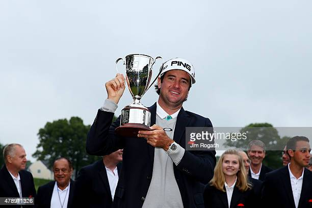 Bubba Watson celebrates with the winner's trophy after the final round of the Travelers Championship at TPC River Highlands on June 28 2015 in...