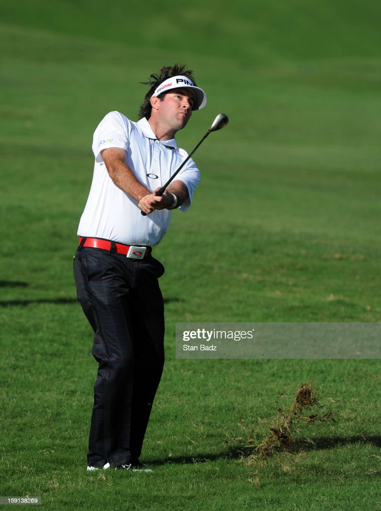 <a gi-track='captionPersonalityLinkClicked' href=/galleries/search?phrase=Bubba+Watson&family=editorial&specificpeople=597658 ng-click='$event.stopPropagation()'>Bubba Watson</a> chips onto the ninth green during the final round of the Hyundai Tournament of Champions at Plantation Course at Kapalua on January 8, 2013 in Kapalua, Maui, Hawaii.