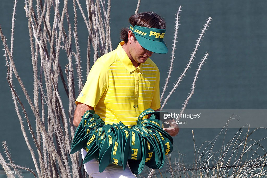 Bubba Watson hands out Ping visors on the 16th hole during the third round of the Waste Management Phoenix Open at TPC Scottsdale on February 2, 2013 in Scottsdale, Arizona.