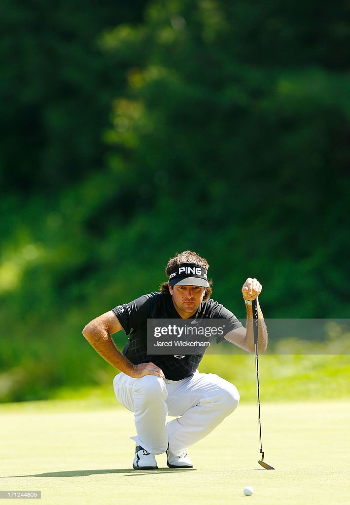 <a gi-track='captionPersonalityLinkClicked' href=/galleries/search?phrase=Bubba+Watson&family=editorial&specificpeople=597658 ng-click='$event.stopPropagation()'>Bubba Watson</a> lines up his putt on the 8th green during the final round of the 2013 Travelers Championship at TPC River Highlands on June 23, 2012 in Cromwell, Connecticut.
