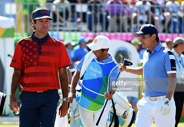 Bubba Watson of the United States and Emiliano Grillo of Argentina walk from the first tee during the final round of golf on Day 9 of the Rio 2016...