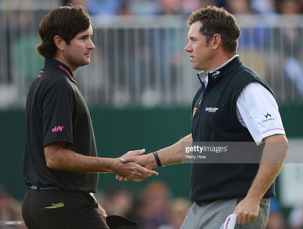 Bubba Watson of the United States and Lee Westwood of England shake hands following the eighteenth hole during the second round of the 141st Open Championship at Royal Lytham & St Annes Golf Club on July 20, 2012 in Lytham St Annes, England.