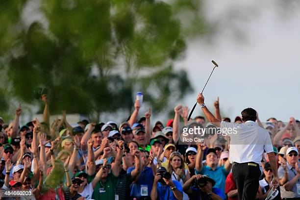 Bubba Watson of the United States celebrates on the 18th green after winning the 2014 Masters Tournament by a threestroke margin at Augusta National...