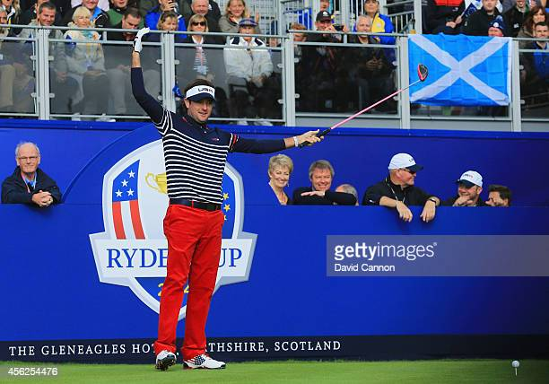 Bubba Watson of the United States encourages the crowd on the 1st tee during the Singles Matches of the 2014 Ryder Cup on the PGA Centenary course at...