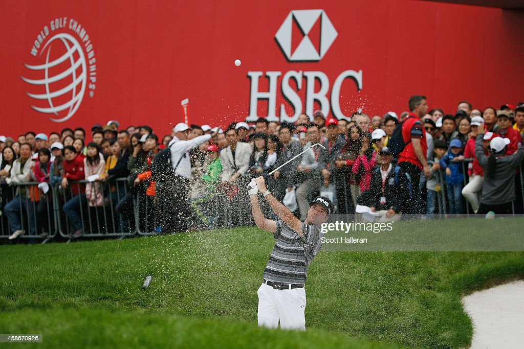 Bubba Watson of the United States hits a bunker shot on the 18th hole during the final round of the WGC HSBC Champions at the Sheshan International...
