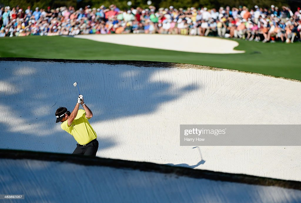 <a gi-track='captionPersonalityLinkClicked' href=/galleries/search?phrase=Bubba+Watson&family=editorial&specificpeople=597658 ng-click='$event.stopPropagation()'>Bubba Watson</a> of the United States hits a shot from a fairway bunker on the 18th hole during the first round of the 2014 Masters Tournament at Augusta National Golf Club on April 10, 2014 in Augusta, Georgia.
