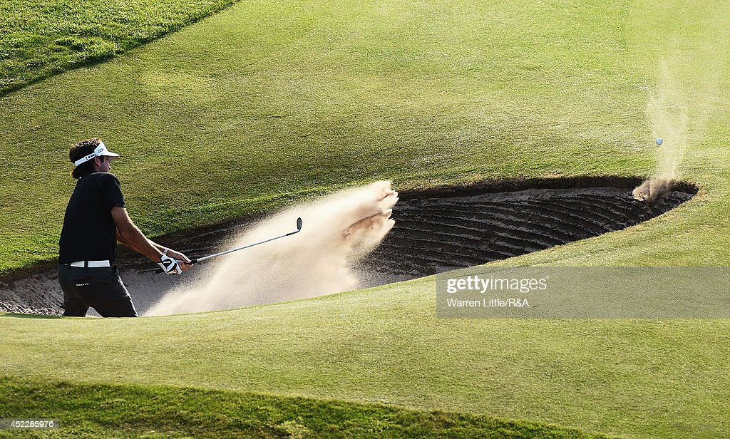 <a gi-track='captionPersonalityLinkClicked' href=/galleries/search?phrase=Bubba+Watson&family=editorial&specificpeople=597658 ng-click='$event.stopPropagation()'>Bubba Watson</a> of the United States hits the lip of the bunker and leaves it in the trap on the 18th hole during the first round of The 143rd Open Championship at Royal Liverpool on July 17, 2014 in Hoylake, England.