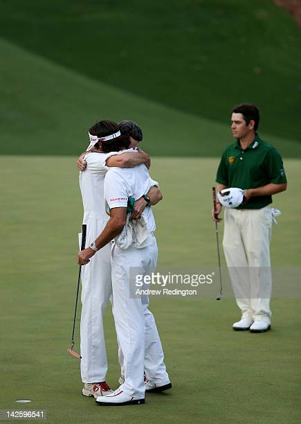Bubba Watson of the United States hugs his caddie Ted Scott after winning his sudden death playoff on the second playoff hole to win the 2012 Masters...