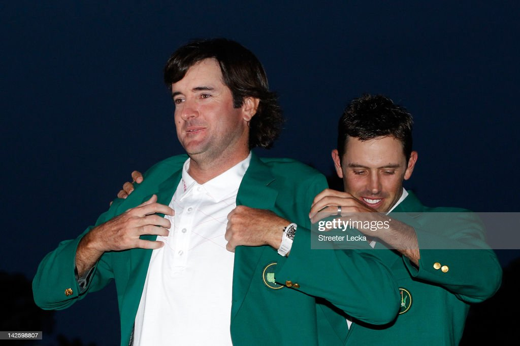 <a gi-track='captionPersonalityLinkClicked' href=/galleries/search?phrase=Bubba+Watson&family=editorial&specificpeople=597658 ng-click='$event.stopPropagation()'>Bubba Watson</a> of the United States (L) is awarded the green jacket by <a gi-track='captionPersonalityLinkClicked' href=/galleries/search?phrase=Charl+Schwartzel&family=editorial&specificpeople=213793 ng-click='$event.stopPropagation()'>Charl Schwartzel</a> of South Africa (R) during the green jacket presentation after his one-stroke playoff victory during the 2012 Masters Tournament at Augusta National Golf Club on April 8, 2012 in Augusta, Georgia.