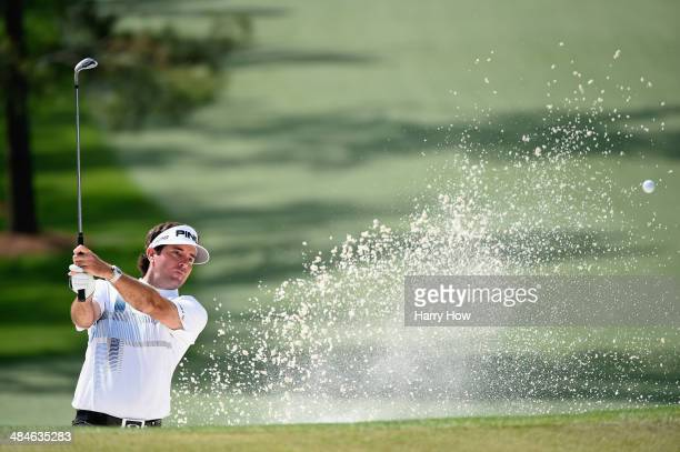 Bubba Watson of the United States plays a bunker shot on the seventh hole during the final round of the 2014 Masters Tournament at Augusta National...