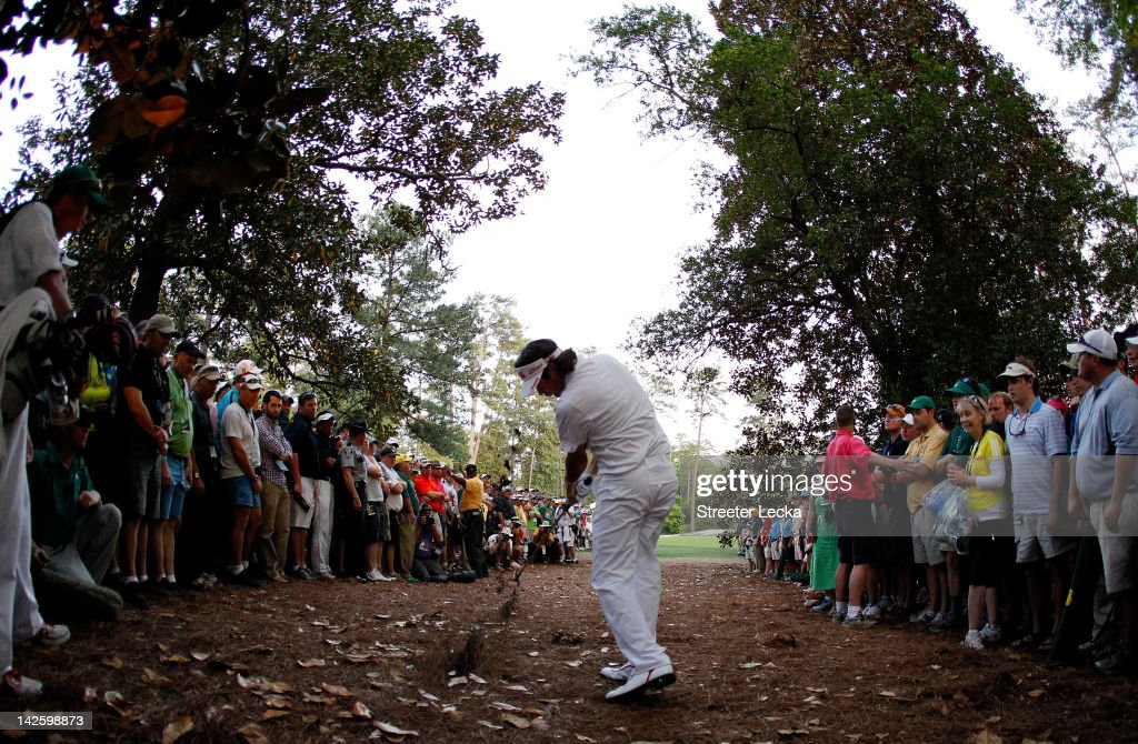 <a gi-track='captionPersonalityLinkClicked' href=/galleries/search?phrase=Bubba+Watson&family=editorial&specificpeople=597658 ng-click='$event.stopPropagation()'>Bubba Watson</a> of the United States plays at a shot from the rough on second sudden death playoff hole on the 10th during the final round of the 2012 Masters Tournament at Augusta National Golf Club on April 8, 2012 in Augusta, Georgia.