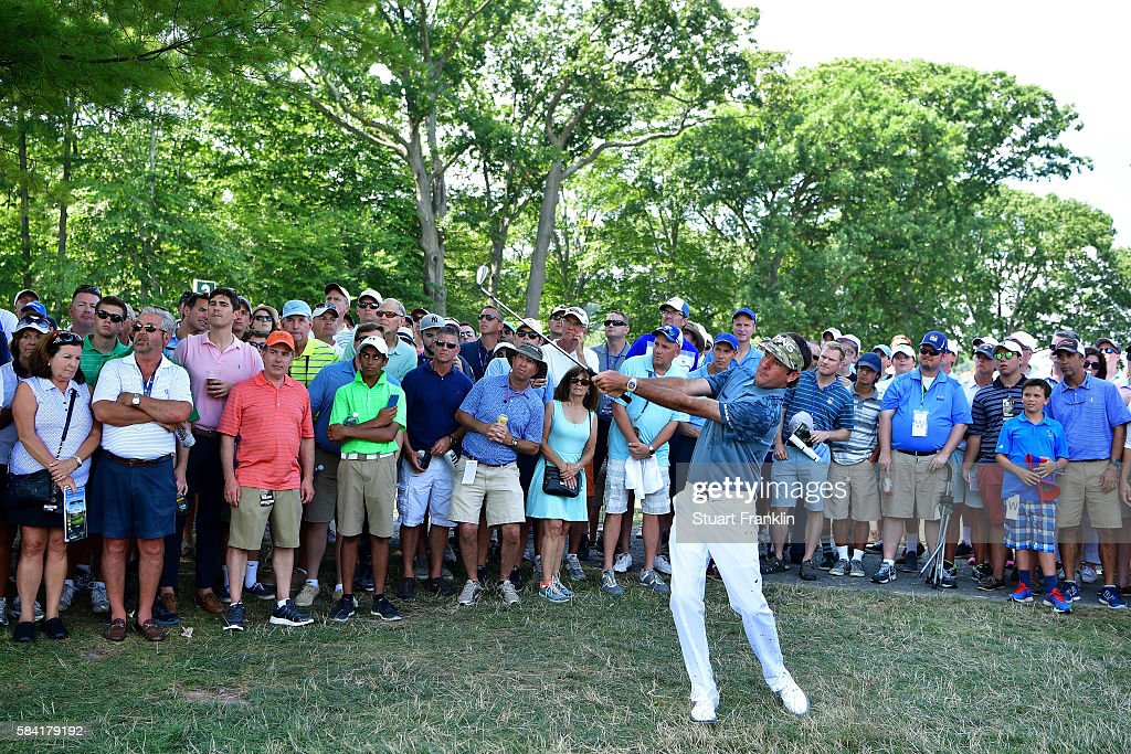 Bubba Watson of the United States plays his second shot on the second hole in front of a gallery of fans during the first round of the 2016 PGA...