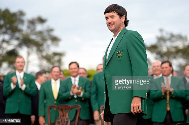 Bubba Watson of the United States poses with the green jacket after winning the 2014 Masters Tournament by a threestroke margin at Augusta National...