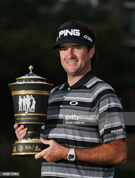 Bubba Watson of the United States poses with the trophy after winning the WGC HSBC Champions at the Sheshan International Golf Club on November 9...